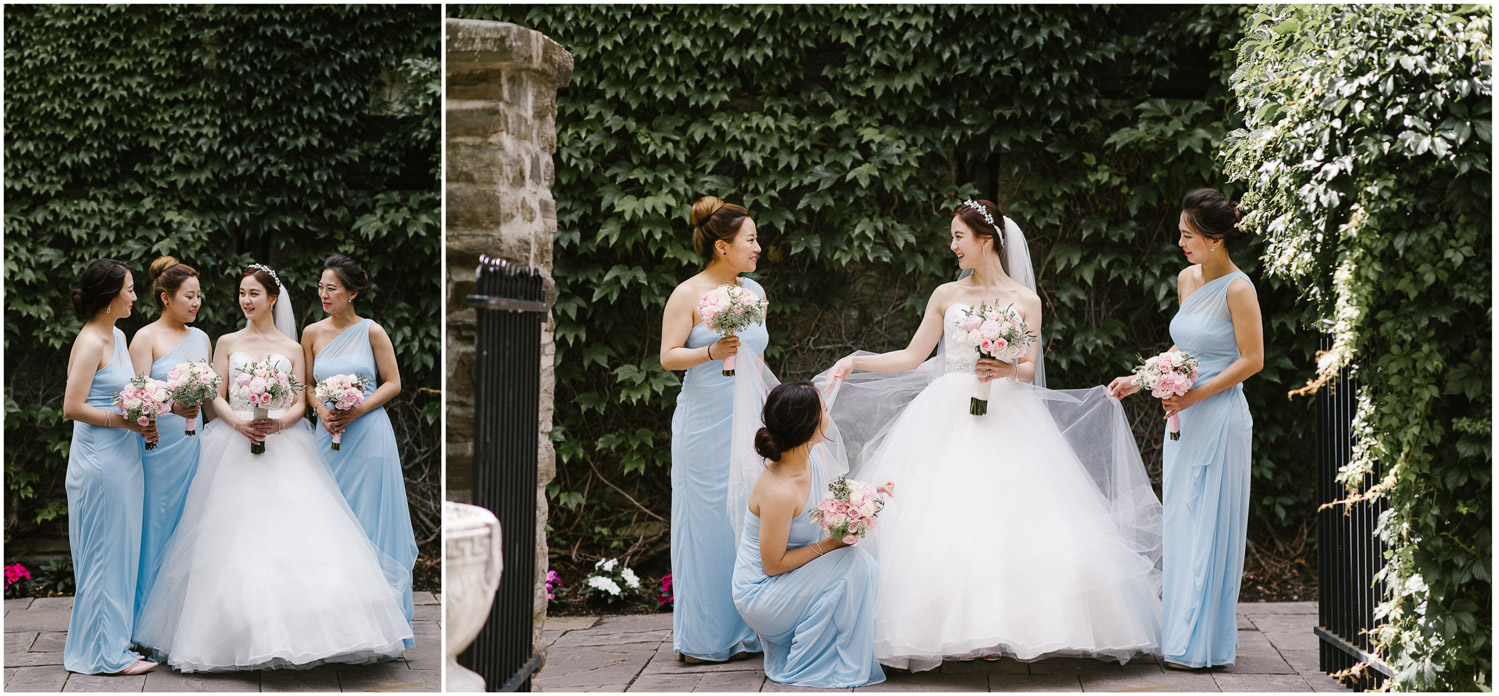 Bridesmaids portrait outside of ivy covered stone walls in Old Mill