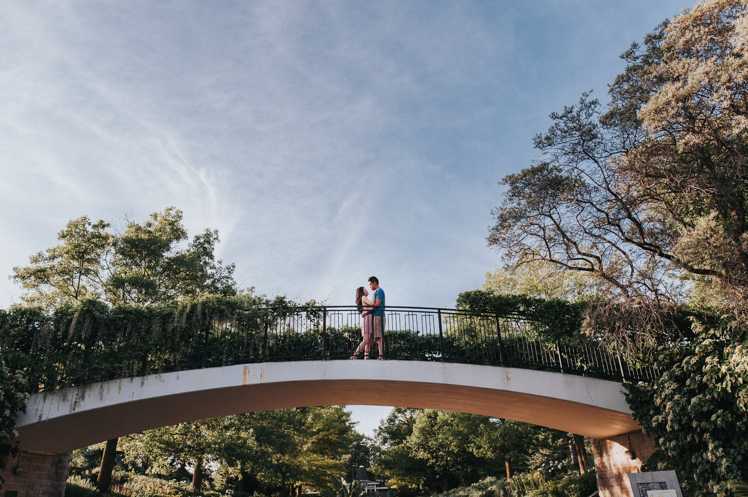 Dreamy sunlight Botanical garden engagement shoot