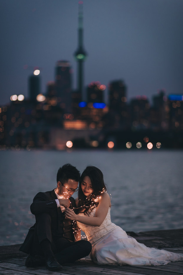 Toronto Downtown skyline Engagement Photo at night with string lights