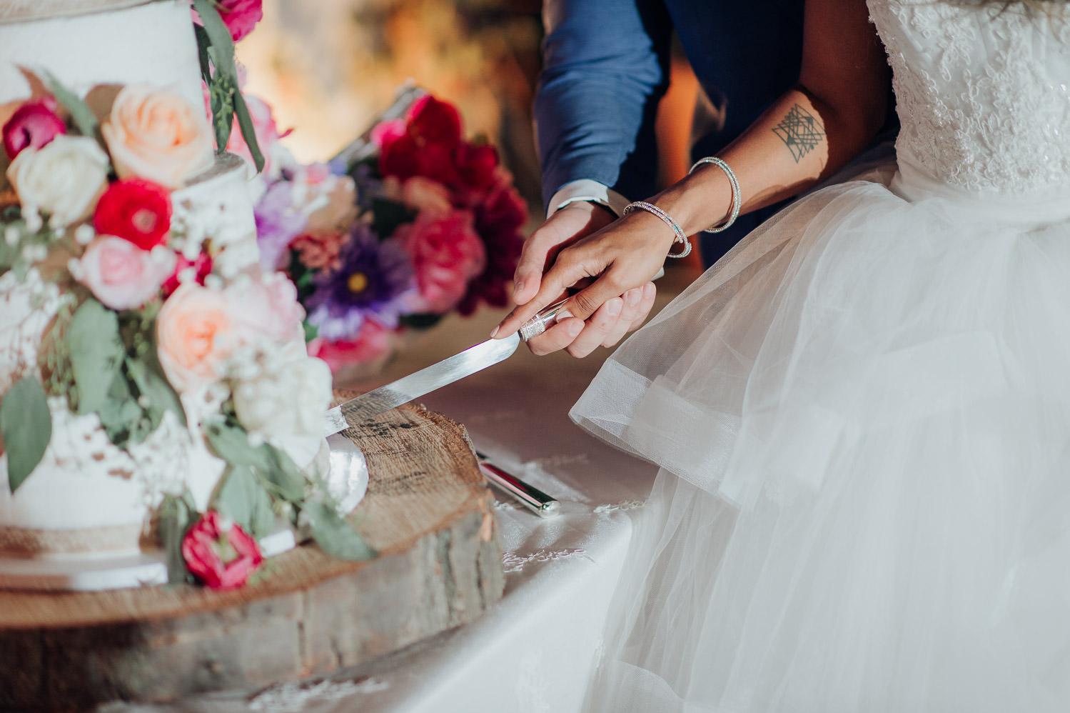 Cake cutting photo at a Toronto wedding featuring Sammycakes