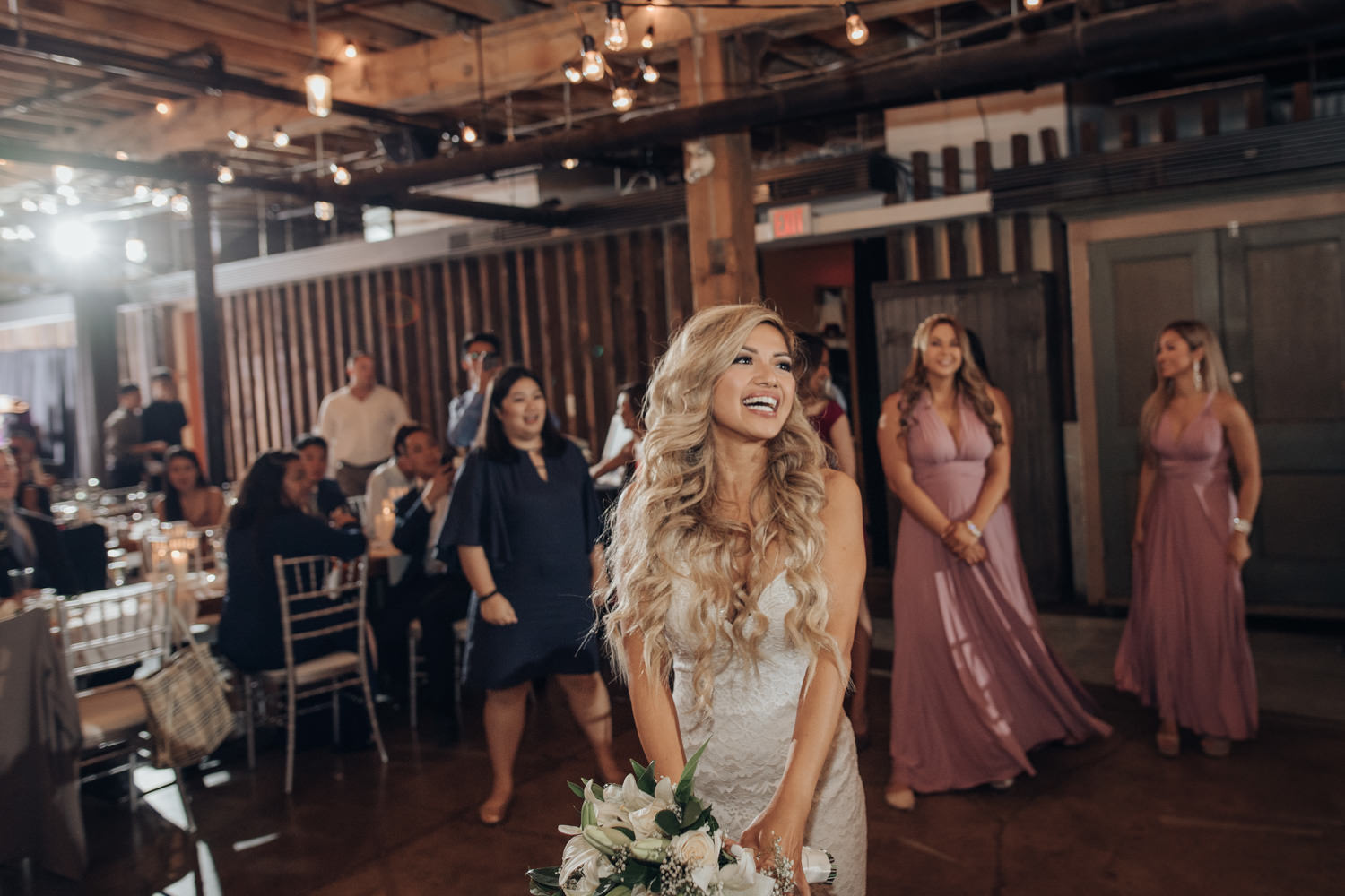 The Loft Indoor Wedding Reception Bouquet Toss