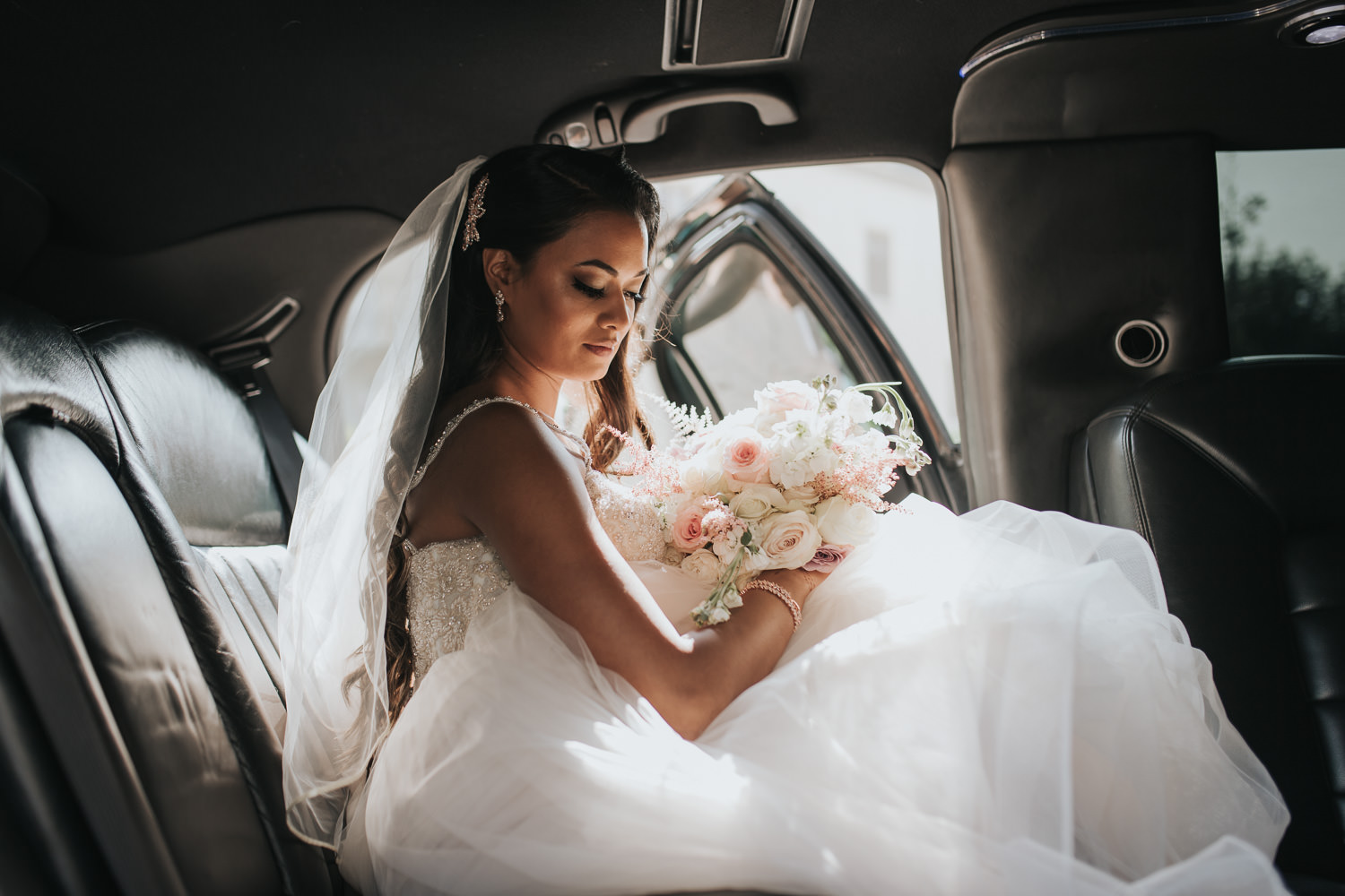 Bride Alone Portrait in limousine