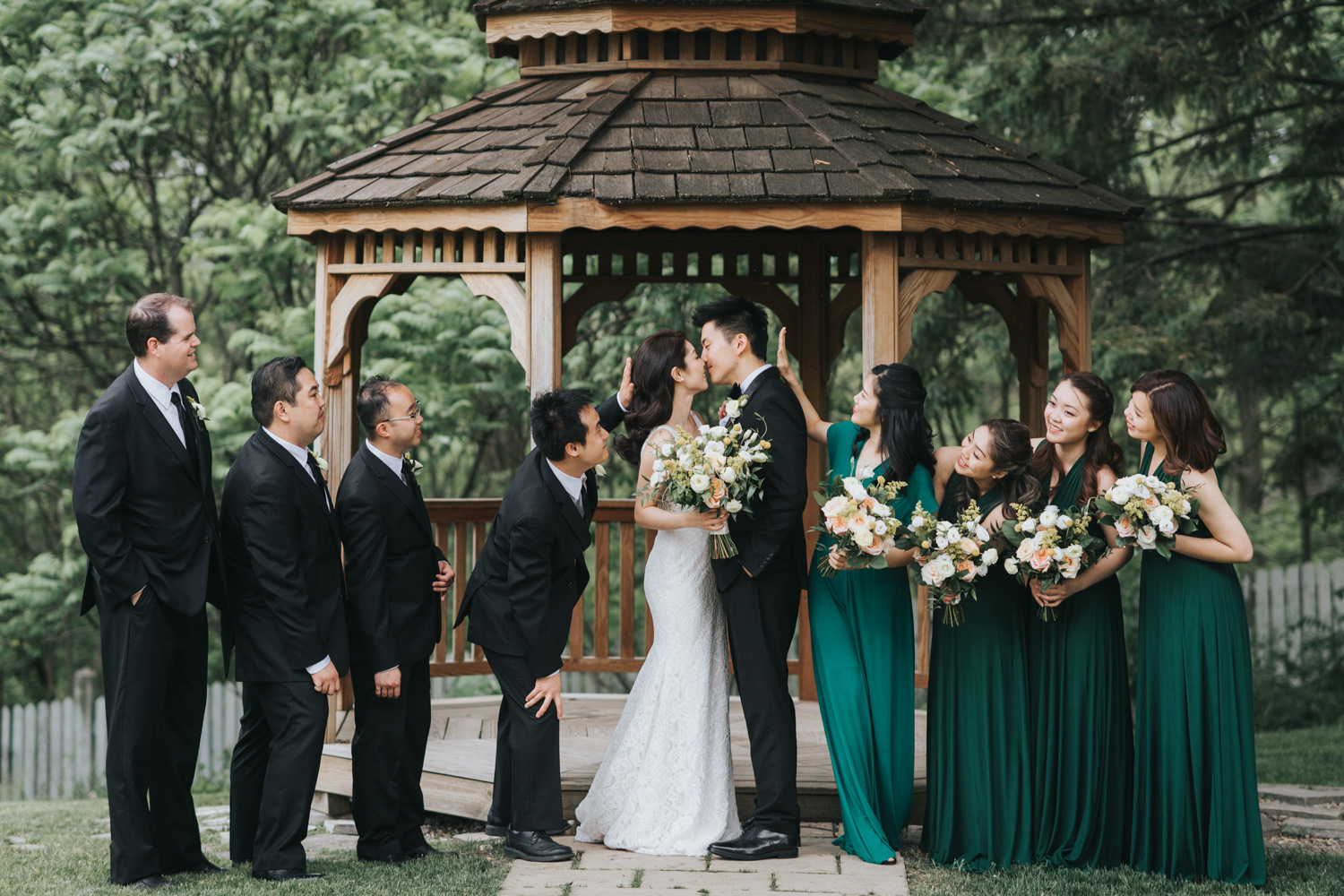 Doctor's House wedding bridal party at wooden gazebo fun