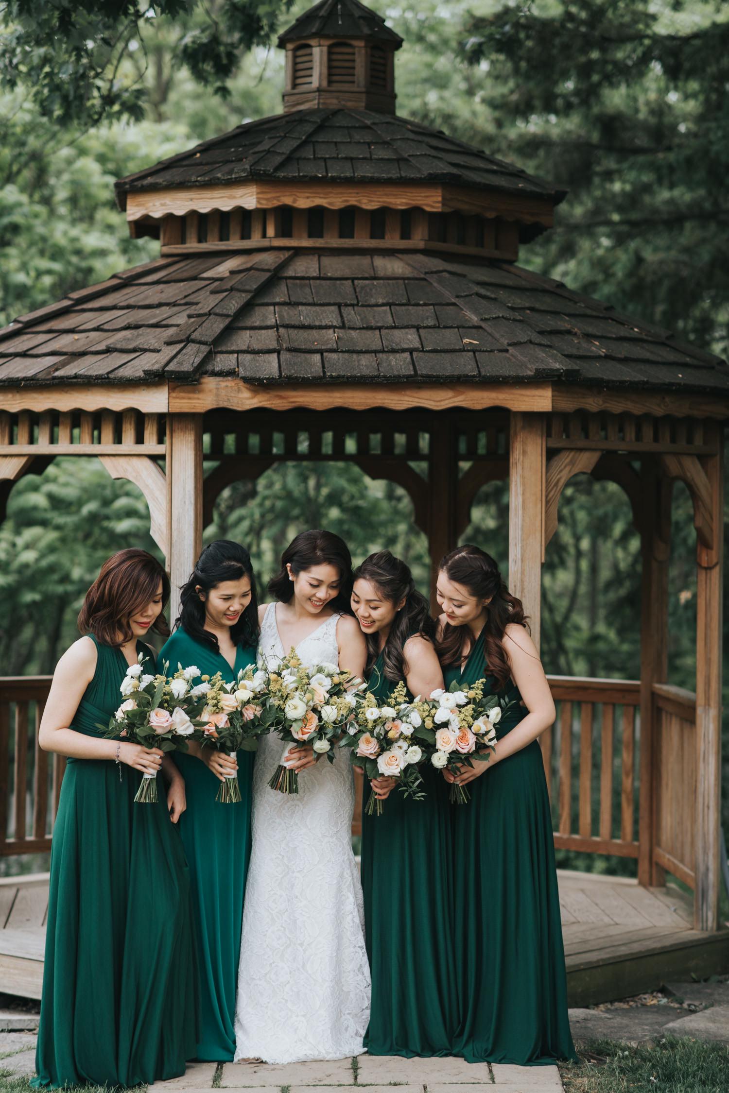 Doctor's House bride and bridesmaids at wooden gazebo photos