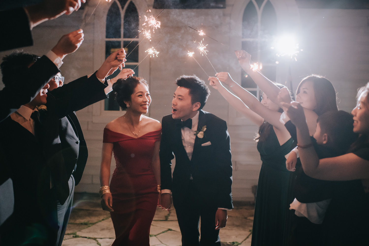 Doctor's House wedding reception evening portrait with sparklers romantic cheerful