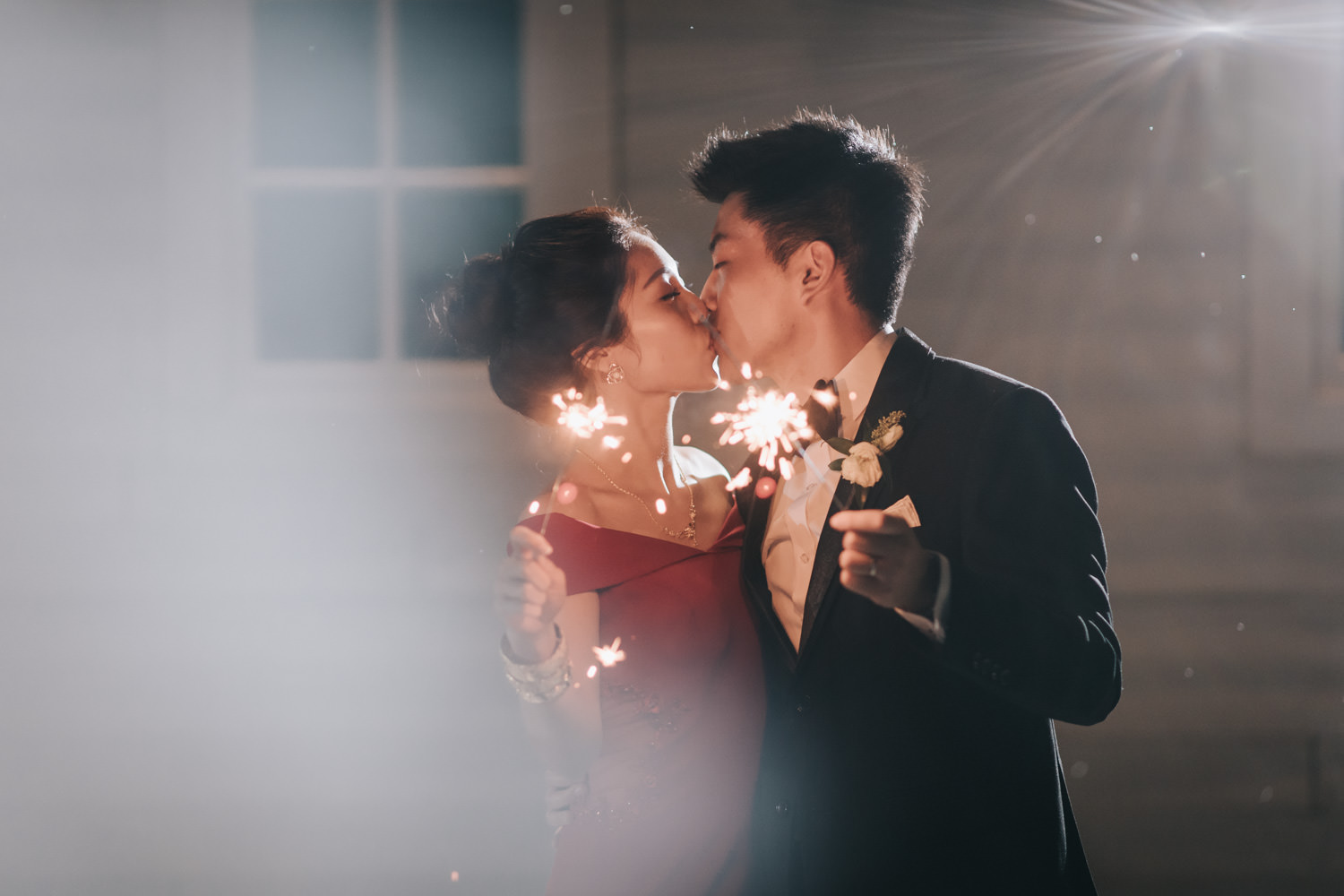 Doctor's House wedding reception evening portrait with sparklers romantic