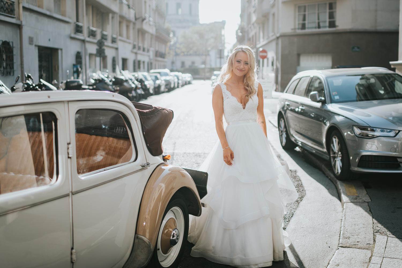 Paris elopement wedding photo bride getting out of car portrait