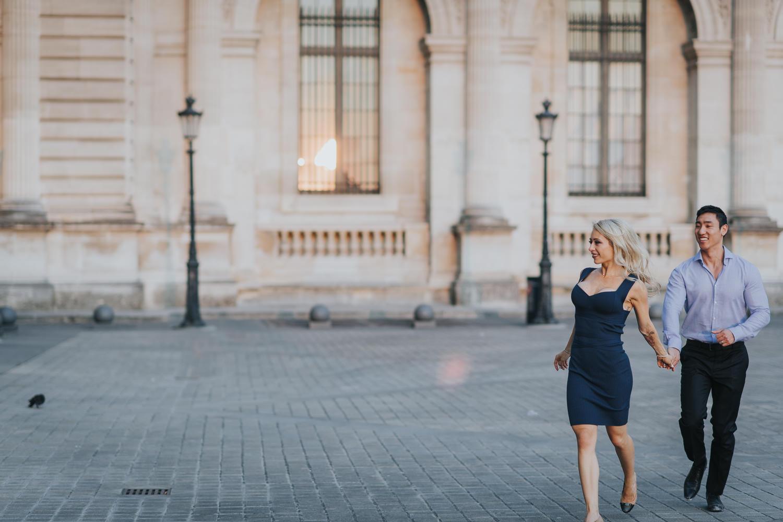 romantic Paris engagement couple running