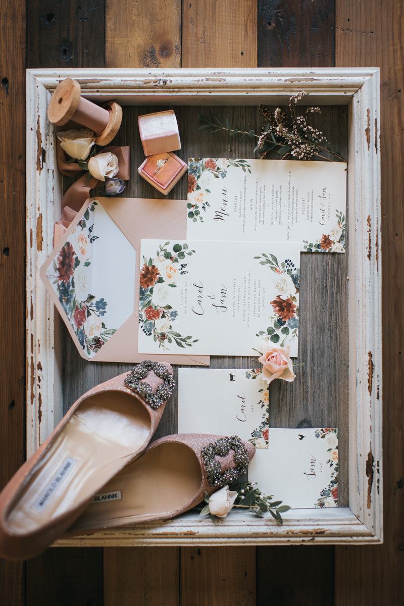 Bride's Wedding Detail with shoes, invitation cards, menu, rings and ribbon spoofs