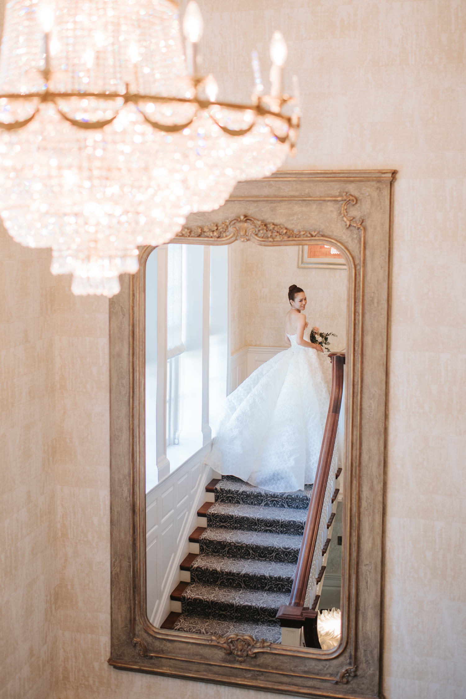 Portrait of bride walking up the stairs inside the Graydon Hall Manor
