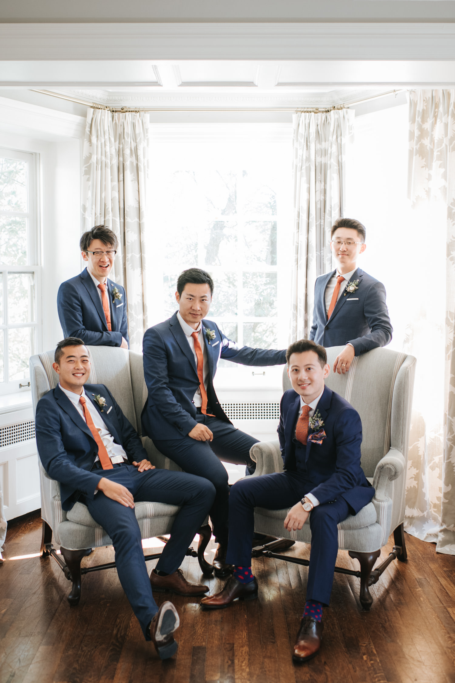 Portrait of groom and his groomsmen inside the Graydon Hall Manor
