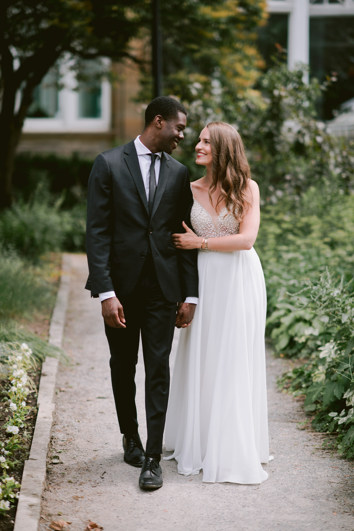 Intimate wedding elopement at Allan Gardens Toronto photography, couple walking to ceremony