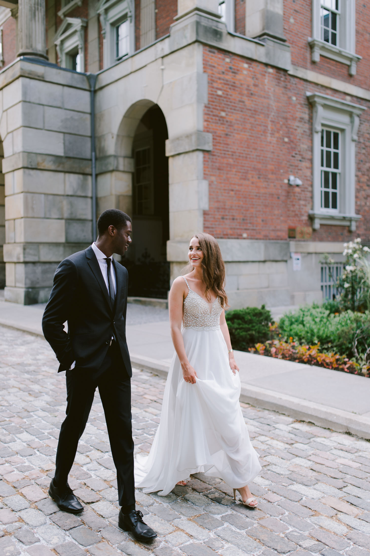 Editorial luxurious wedding photography at Osgoode Hall Toronto couple walking