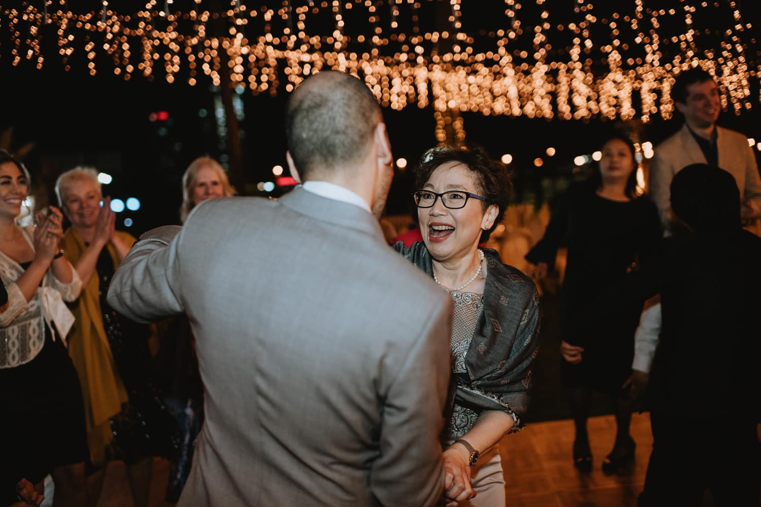 Evening String light Wedding Reception Mother and Groom Dance