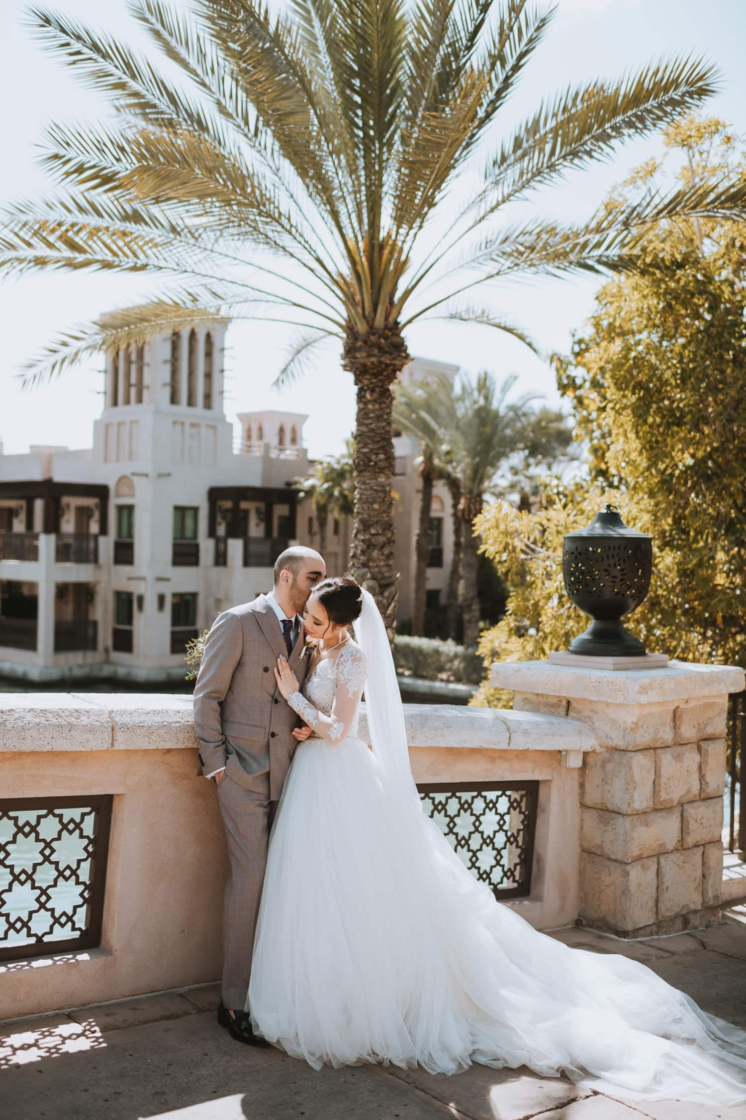 Whimsical Dubai Wedding Photo on the bridge in the Jumeirah Al Qasr resort